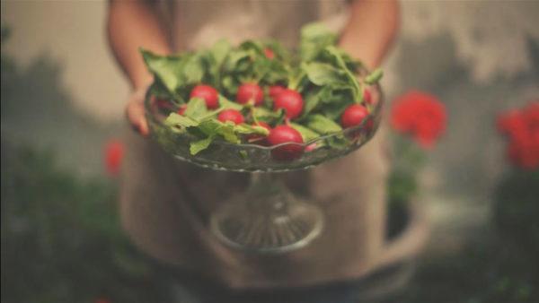 Girl holding radish
