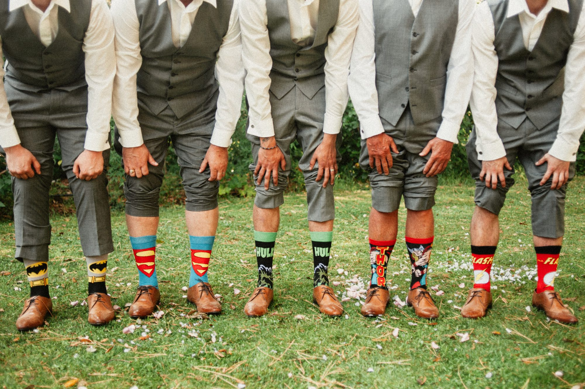 Groomsmen showing their socks in Tuscany